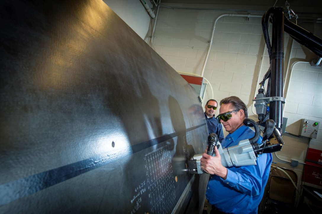 A researcher uses Laser Bond Inspection on a large structure at the Boeing Laser Bond Inspection Laboratory in Seattle, Washington. (Courtesy photo)