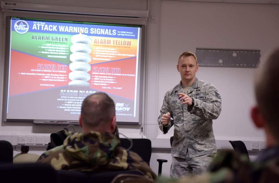 U.S. Air Force Staff Sgt. Bryan Foley, 100th Civil Engineer Squadron NCO in charge of plans and operations, instructs a chemical, biological, radiological and nuclear defense survival skills class at RAF Mildenhall, England Jan. 22, 2018.  CBRN training ensures Airmen are ready to fight in any warfighting scenario. (U.S. Air Force photo by Senior Airman Alexandra West)