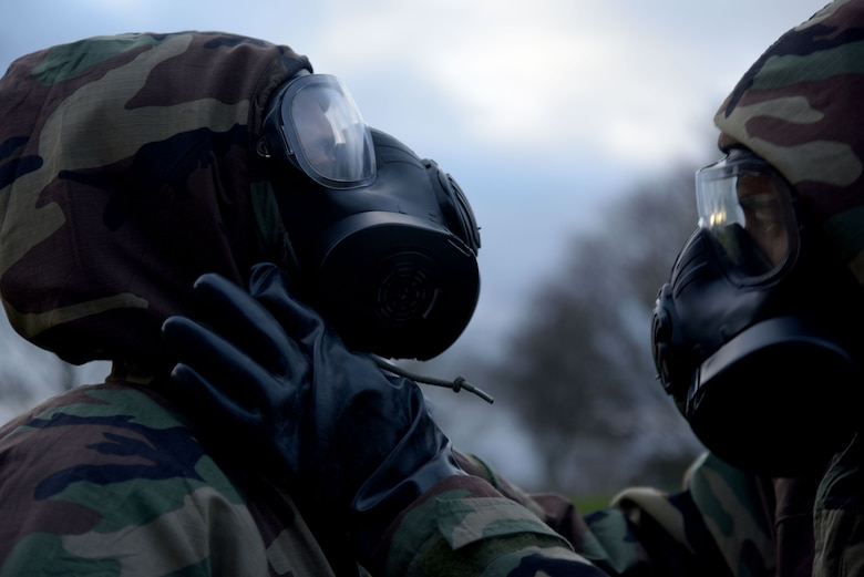 U.S. Airmen assigned to the 100th Air Refueling Wing perform buddy checks during a chemical, biological, radiological and nuclear defense survival skills class at RAF Mildenhall, England, Jan. 23, 2018. Buddy checks ensure an individual has donned his or her mission oriented protective posture gear properly. (U.S. Air Force photo by Senior Airman Alexandra West)