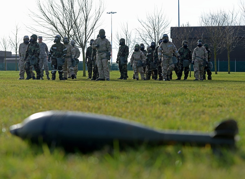 U.S. Airmen assigned to the 100th Air Refueling Wing conduct a post attack reconnaissance sweep during a chemical, biological, radiological and nuclear defense survival skills class at RAF Mildenhall, England, Jan. 30, 2018. During a PAR sweep, Airmen perform searches around their facilities looking for unexploded ordnance and evidence of chemical agents. (U.S. Air Force photo by Senior Airman Alexandra West)