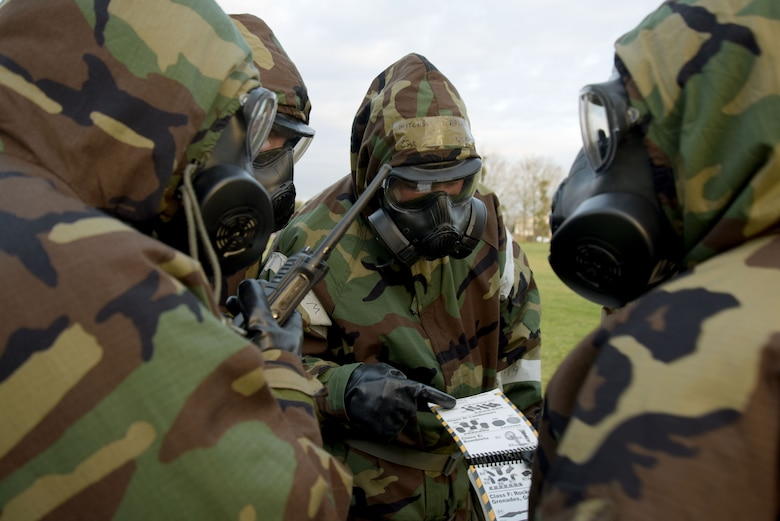U.S. Airmen assigned to the 100th Air Refueling Wing identify the type of unexploded ordnance found during a post attack reconnaissance sweep exercise at RAF Mildenhall, England, Jan. 22, 2018.  Conducting a PAR sweep is part of the chemical, biological, radiological and nuclear defense survival skills class. (U.S. Air Force photo by Senior Airman Alexandra West)