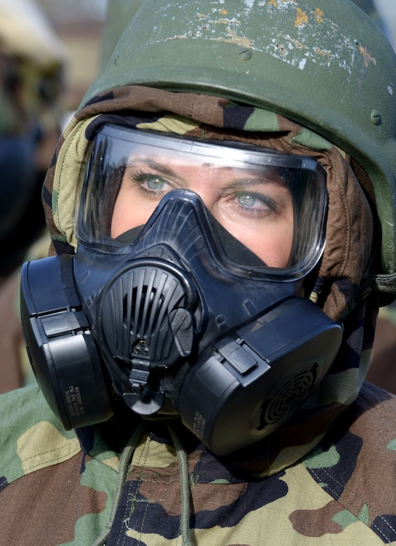 U.S. Air Force Tech. Sgt. Nicola Adams, 100th Air Refueling Wing Command Post NCO in charge of console operations, listens to a chemical, biological, radiological and nuclear defense survival skills class instructor at RAF Mildenhall, England, Jan. 30, 2018. Since readiness is a high priority for the Air Force and for the 100th Air Refueling Wing, Airmen must be current in CBRN operations at all times. (U.S. Air Force photo by Senior Airman Alexandra West)
