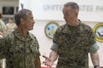 Two military leaders talk together.