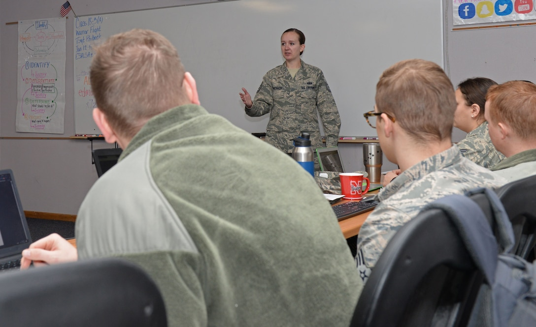 Tech. Sgt. Abigail Philbrick, a Professional Military Education instructor assigned to the 28th Force Support Squadron, explains the difference of professional and unprofessional qualities in supervisors inside the Samuel O. Turner Airman Leadership School building at Ellsworth Air Force Base, S.D., Jan. 16, 2018. ALS is a month-long PME course devoted to building the foundation of supervisory skills necessary to be a noncommissioned officer. (U.S. Air Force photo by Airman 1st Class Nicolas Z. Erwin)