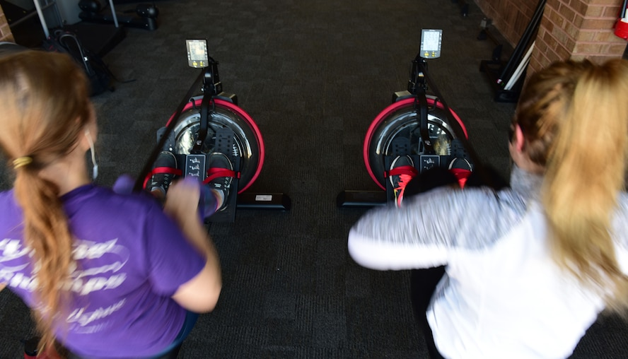 Members of Team Whiteman use rowing machines in the Fitness Center at Whiteman Air Force Base, Mo., Jan. 24, 2018. Each year the Fitness Center hosts a rowing challenge, and this year, for the month of February, members of Team Whiteman are competing against five other Air Force Global Strike Bases to win the first rowing challenge traveling trophy. (U.S. Air Force photo by Staff Sgt. Danielle Quilla)