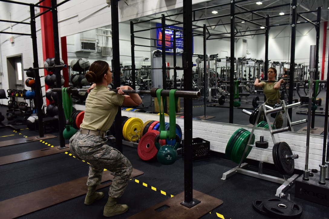 U.S. Air Force Staff Sgt. Elizabeth Lavaring, a fitness instructor assigned to the 509th Force Support Squadron, performs a barbell squat in the Fitness Center at Whiteman Air Force Base, Mo., Jan. 24, 2018. The weight room has a variety of specialty weight equipment and a large assortment of free weights for those with strength training and muscle toning in mind. (U.S. Air Force photo by Staff Sgt. Danielle Quilla)
