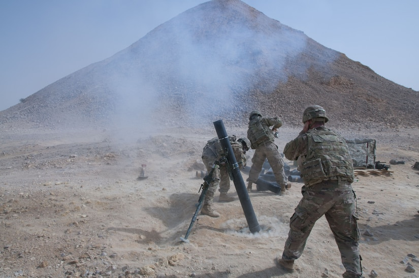 A mortar crew with Headquarters and Headquarters Company, 1st Battalion, 35th Armored Regiment, 2nd Armored Brigade Combat Team, 1st Infantry Division, fires a 120mm mortar in support of U.S. and Omani forces, Jan 29. 2018, during Inferno Creek 2018 near Thumrait, Oman. Inferno Creek 2018 is an annual Omani-U.S. exercise focused on building bilateral ties between the two militaries. This is the first time the exercise was held at the company level.