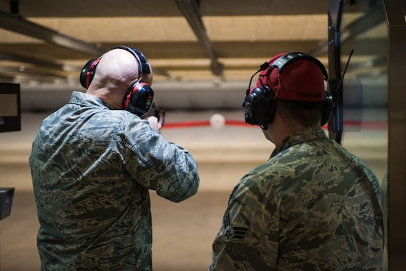 U.S. Air Force Col. Michael Manion, 55th Wing commander, prepares to fire during the ribbon shooting ceremony for the new combat arms firing range at Offutt Air Force Base, Neb. Jan. 29, 2018.