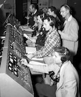 Technicians and engineers monitor the countdown for the liftoff of Explorer 1 in the control room of the blockhouse at Space Launch Complex 26 at the Cape Canaveral Missile Annex (now Cape Canaveral Air Force Station). (Courtesy photo by NASA)