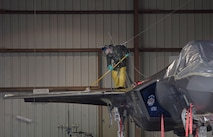 Airman 1st Class Landon Overshiner, 33rd Aircraft Maintenance Squadron crew chief, cleans the top of an F-35A Lightning II, Jan. 8, 2018, at Eglin Air Force Base, Fla. (U.S. Air Force photo by Staff Sgt. Peter Thompson)
