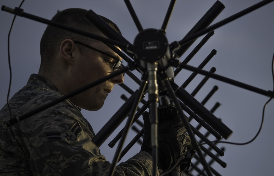 Airman 1st Class Colin Martin, 5th Communications Squadron radio frequency transport system apprentice, adjusts an antenna in support of a strategic bomber deployment at RAF Fairford, England, Jan. 10, 2018. The deployment of strategic bombers to the United Kingdom helps exercise U.S. Air Forces in Europe's forward operating location for bombers. Training with joint partners, allied nations and other U.S. Air Force units help the 5th Bomb Wing contribute to ready and postured forces. (U.S. Air Force photo by Staff Sgt. Trevor T. McBride)