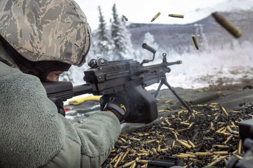 Airman 1st Class Kaylon Thomas fires at a target with an M249 squad automatic weapon during a machine gun qualification at Joint Base Elmendorf-Richardson, Alaska, Jan. 10, 2018. Thomas is a security forces officer assigned to the 673rd Security Forces Squadron. (U.S. Air Force photo by Justin Connaher)