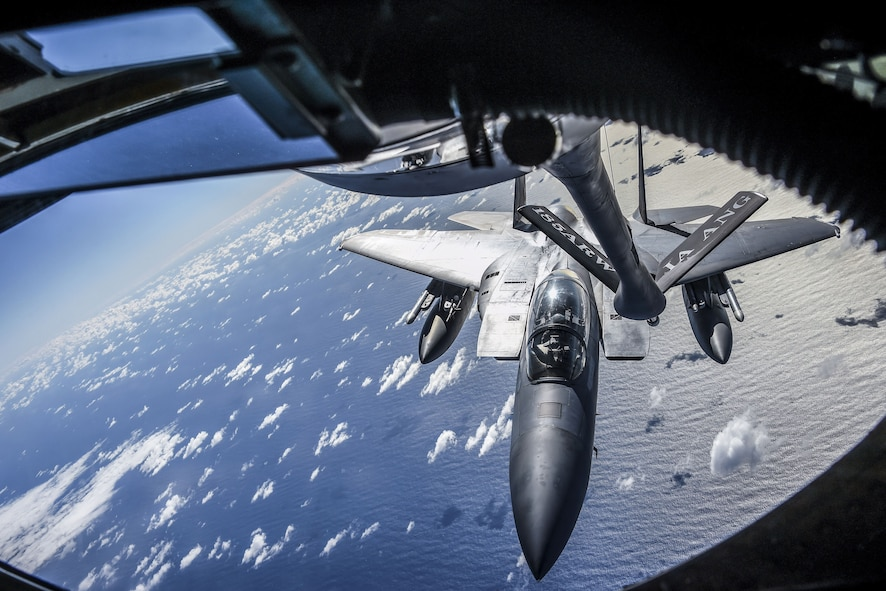 A U.S. Air Force F-15 Eagle from California Air National Guard's 144th Fighter Wing approaches the boom of a KC-135 Stratotanker from Iowa ANG's 185th Air Refueling Wing during Sentry Aloha 18-01 above Joint Base Pearl Harbor-Hickam, Hawaii Jan. 17, 2018. Sentry Aloha provides tailored, cost effective and realistic combat training for U.S. Air Force, Air National Guard and other Department of Defense services to provide U.S. warfighters with the skill sets necessary to perform their homeland defense and overseas combat missions. (Air National Guard photo by Senior Master Sgt. Chris Drudge)