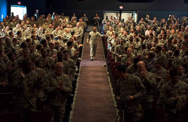 "Chief Master Sgt. of the Air Force Kaleth O. Wright, makes his way down an aisle at the Sheppard Air Force Base, Texas, base theater during an ""all call"" assembly, Jan. 25, 2018. The CMSAF addressed issues that affect the lives of Airmen daily and also heard questions and concerns from some of those in attendance. (U.S. Air Force photo by Alan R. Quevy)"