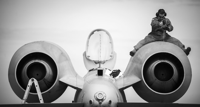 Senior Airman Adam Jurek, from the 122nd hydraulic shop, 122nd Fighter Wing, Fort Wayne, Ind., installs a panel after completing a bleed of the engine hydraulic system on an A-10C Thunderbolt II aircraft during Operation Guardian Blitz, Jan. 25, 2018, at MacDill Air Force Base, Fla. The hard work and dedication of hundreds of maintenance personnel is invaluable to the success of the mission. The 122nd Fighter Wing is ready and prepared to answer the nation's call whenever and wherever. (U.S. Air National Guard photo by Staff Sgt. William Hopper)