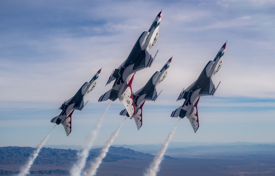 The Thunderbirds Diamond formation pilots transition during a Line Break Loop maneuver over the Nevada Test and Training Range during a training flight, Jan. 29, 2018. The Diamond formation exhibits the precision and skill to fly in close formation. (U.S. Air Force photo by Tech. Sgt. Christopher Boitz)