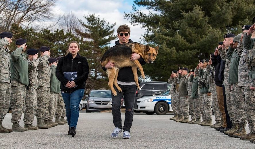 Members of the 436th Security Forces Squadron render a final salute to Rico, a retired military working dog. His former handler and current owner, retired Tech. Sgt. Jason Spangenberg, carried him to the Veterinary Treatment Facility at Dover Air Force Base, Del., Jan. 24, 2018. (U.S. Air Force photo by Roland Balik)