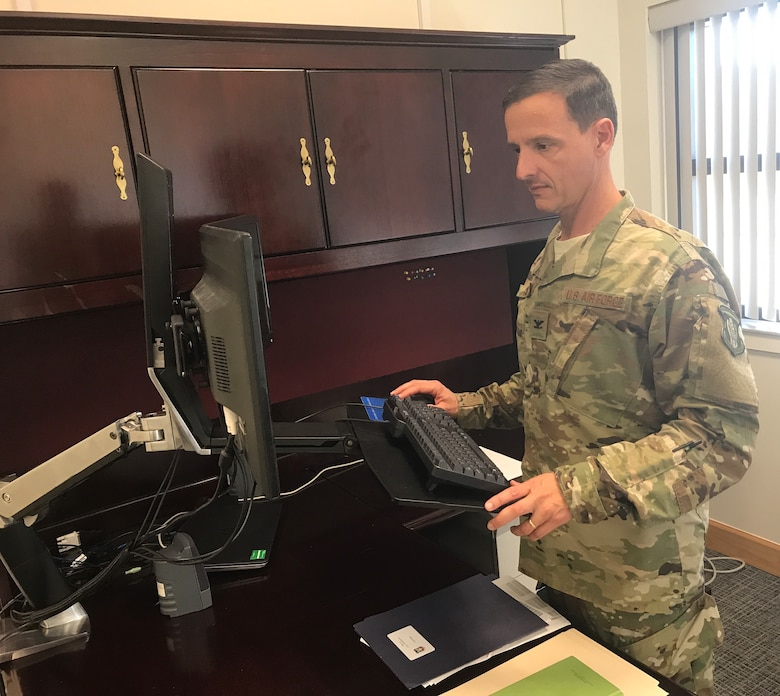 Col. Ian Chase, 920th Rescue Wing vice commander, works from his desk at Patrick AFB, Dec. 3, 2017. Chase joined the combat search and rescue reserve unit Aug. 5, 2017 and brings with him many years of experience as a navigator. In the past, Chase has been assigned to several special operations units including the 711th Special Operations Squadron, Duke Field, Florida. (U.S. Air Force photo by Senior Airman Brandon Kalloo Sanes)