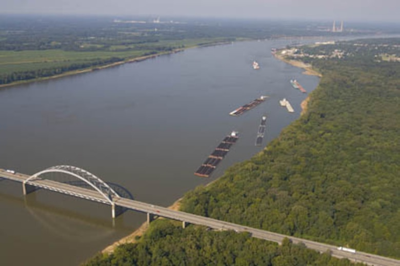 A picture of a barge proceeding to Locks and Dam 52/53