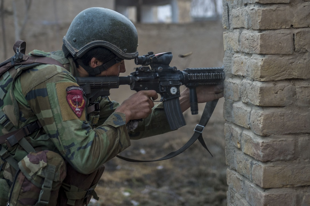 An Afghan national Army 10th Special Operations Kandak Commando returns fire during offensive operations against the Taliban in Kunduz province, Afghanistan, Jan. 20, 2018. (U.S. Air Force photo by Senior Airman Sean Carnes)