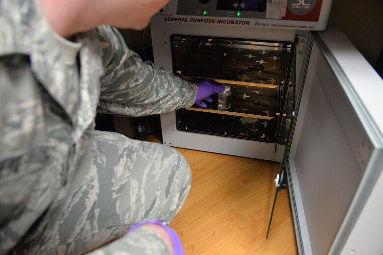 Senior Airman William Raetz, 341st Senior Airman William Raetz, 341st Medical Operations Squadron bioenvironmental engineering technician, places a water sample into an incubator Jan. 31, 2018, at Malmstrom Air Force Base, Mont.
