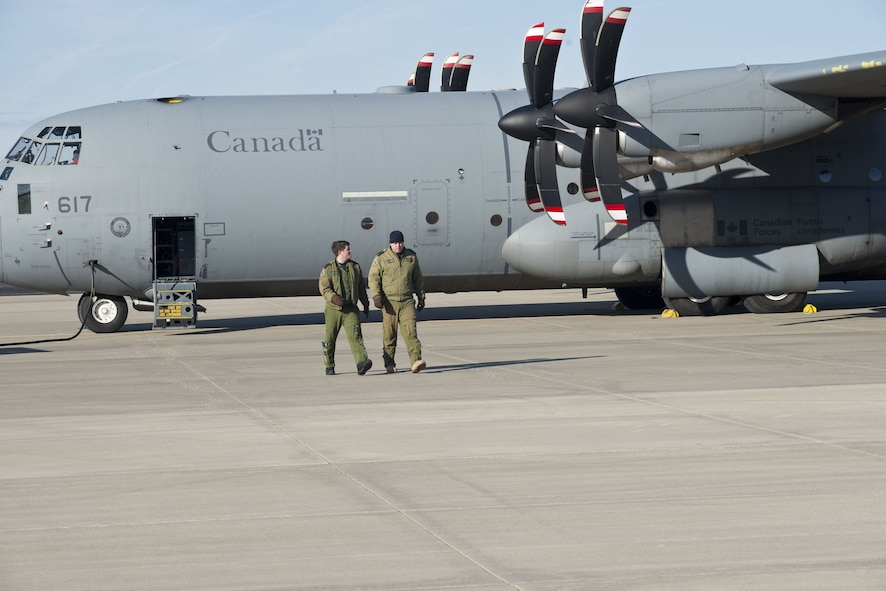 Royal Canadian Air Force members prepare their CC-130J aircraft for a Treaty on Open Skiestraining sortie at Rosecrans Memorial Airport, St. Joesph, Mo. February 2, 2018. Personnel from the United States, Canada, United Kingdom, France and the Czech Republic participated in the flight designed to promote international cooperation and transparency. (U.S. Air National Guard photo/Tech. Sgt. John Hillier)