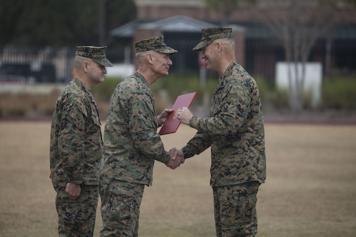 Lt. Gen. Rex C. McMillian, center, commander of Marine Forces Reserve and Marine Forces North, relinquished Sgt. Maj. Patrick J. Kimble, right, of his duties as force sergeant major of MARFORRES and MARFORNORTH, during the relief and appointment ceremony held at Marine Corps Support Facility, New Orleans, Louisiana, Feb. 2, 2018. Kimble served as the force sergeant major from 2016-2018 and has relinquished his duties to Sgt. Maj. Scott D. Grade. (U.S. Marine Corps Photograph by Lance Cpl. Ricardo Davila/Released)