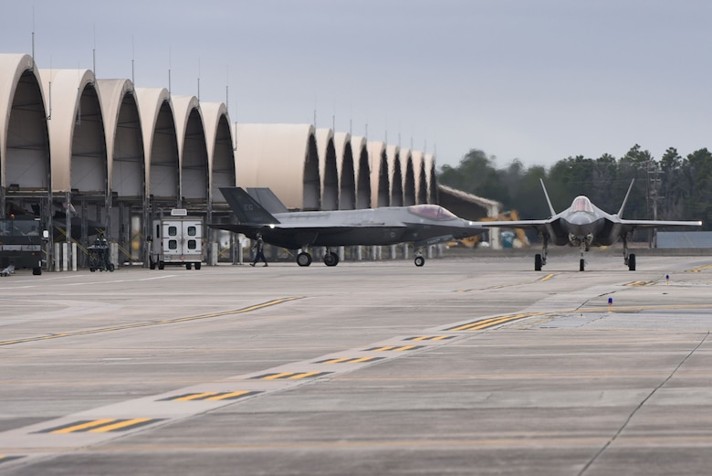 Two F-35As Lightning II taxi prior to taking off for an expanded Lightning Top Off Course Jan. 29, 2018, at Eglin Air Force Base, Fla. The two week expanded LiTOC included combat aircraft from the U.S. Navy and Air Force in a large force exercise aimed at providing F-35A pilots with experience before entering the Combat Air Force. During the expanded LiTOC, pilots receive half of the flights required to complete mission qualification training, drastically reducing their training timeline. (U.S. Air Force photo by Airman 1st Class Emily Smallwood/Released)