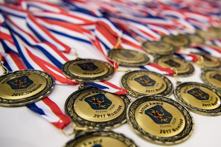 Medallions sit on a table before a Tour of Champions, Feb. 2, 2018, at Moody Air Force Base, Ga. The Tour of Champions recognizes 23d Wing annual award nominees and an opportunity to gain a better perspective of the 23d Wing's mission. (U.S. Air Force photo by Senior Airman Daniel Snider)