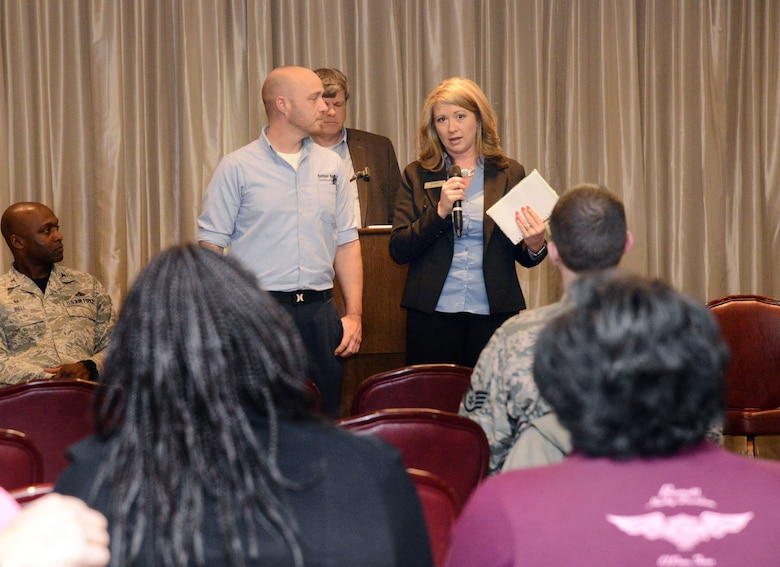 Mike Green, left, facility manager, and Ashleigh Talk, community manager for Balfour Beatty Communities, talk about the company's continued improvement of quality of service and professionalism of vendors and staff during the Tinker Town Hall Jan. 26 at the Tinker Club.