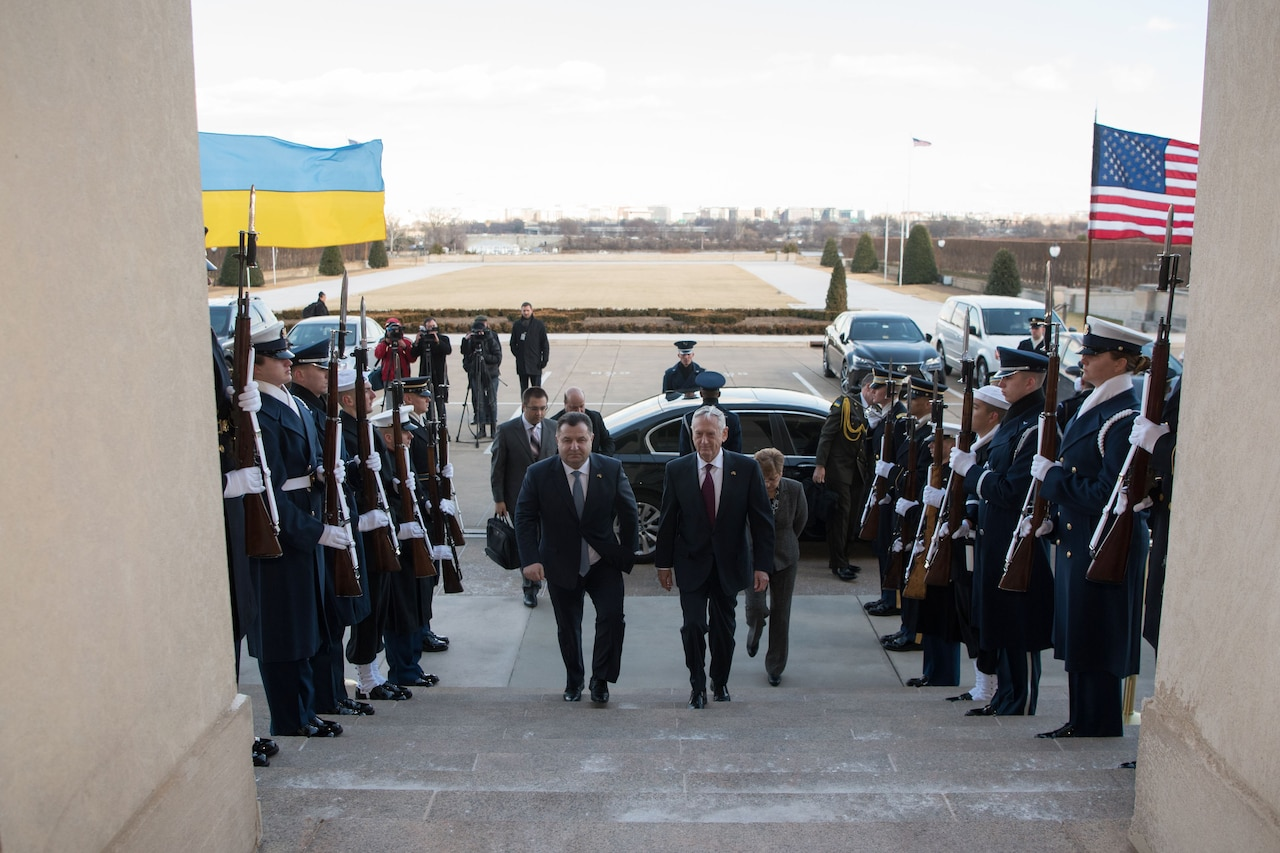 Defense Secretary James N. Mattis walks with Ukrainian Defense Minister Stepan Poltorak past troops and into the Pentagon.