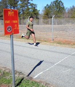 Marines participate in a mock Physical Fitness Test