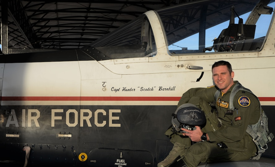 Capt. Hunter Barnhill, a 37th Flying Training Squadron instructor pilot, sits on the wing of his T-6A Texan II Jan. 26, 2018, on Columbus Air Force Base, Mississippi. Galatians 2:20 is one of the first verses, after his brain surgery, he had memorized and is a passage he attributes to his recovery going well. The spiritual pillar is a key component to an Airman's resiliency and strength. (U.S. Air Force photo by Airman 1st Class Keith Holcomb)