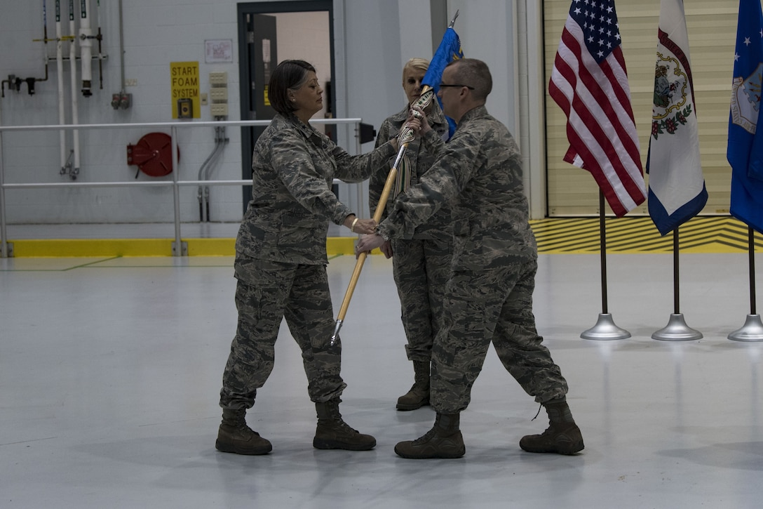 U.S. Air Force Brig. Gen. Paige Hunter (left), the West Virginia National Guard Assistant Adjutant General - Air, gives command of the 130th Maintenance Group to U.S. Air Force Col. Patrick Chard at the 130th MXG change of command Feb. 1, 2018 at McLaughlin Air National Guard Base, Charleston, W.Va.Chard is assuming the command of the 130th MXG after being the Director of Staff at Headquarters West Virginia Air National Guard.(U.S. Air National Guard Photo by Airman 1st Class Caleb Vance)