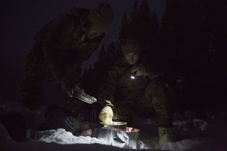 Marines with Task Force Arctic Edge boil snow into water to replenish reserves during a cold weather training exercise at Marine Corps Mountain Warfare Training Center, Bridgeport, Calif., Jan. 27, 2018. Approximately 90 Marines participated in the week-long event where they learned survival skills, how to traverse mountainous terrain and cold weather weapons maintenance. The training will prepare the Marines for joint-force training exercise Artic Edge in northern Alaska, which will expose Marines to the peninsula's weather extremes. (U.S. Marine Corps photo by Sgt. Brianna Gaudi)