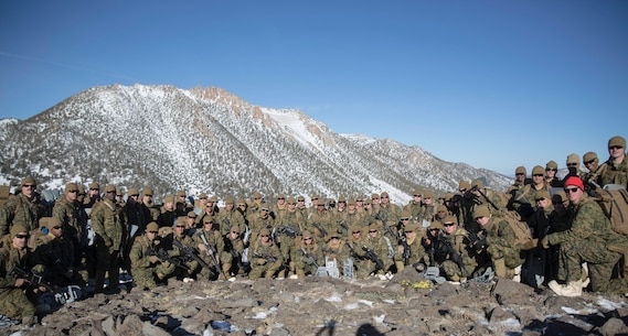 Marines with Combat Logistics Regiment 25, 2nd Marine Logistics Group pose for a group photo cold weather training at Marine Corps Mountain Warfare Training Center, Bridgeport, Calif., Jan. 28, 2018. Approximately 90 Marines participated in the week-long event where they learned survival skills, how to traverse mountainous terrain and cold weather weapons maintenance. The training will prepare the Marines for joint-force training exercise Artic Edge in northern Alaska, which will expose Marines to the peninsula's weather extremes. (U.S. Marine Corps photo by Sgt. Brianna Gaudi)