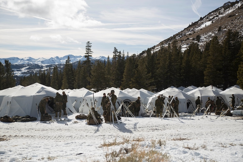 Marines with Task Force Arctic Edge prepare for their day during cold weather training at Marine Corps Mountain Warfare Training Center, Bridgeport, Calif., Jan. 28, 2018. Approximately 90 Marines participated in the week-long event where they learned survival skills, how to traverse mountainous terrain and cold weather weapons maintenance. The training will prepare the Marines for joint-force training exercise Artic Edge in northern Alaska, which will expose Marines to the peninsula's weather extremes. (U.S. Marine Corps photo by Sgt. Brianna Gaudi)