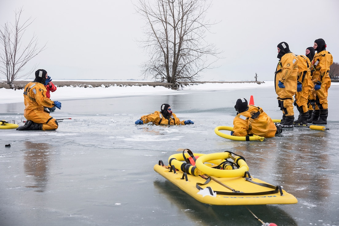 Phill Ulmer, chief of public affairs, 127th Wing here, practices self-rescue techniques during an ice rescue training exercise on Lake St. Clair, Harrison Township, Mich. on Jan. 31,