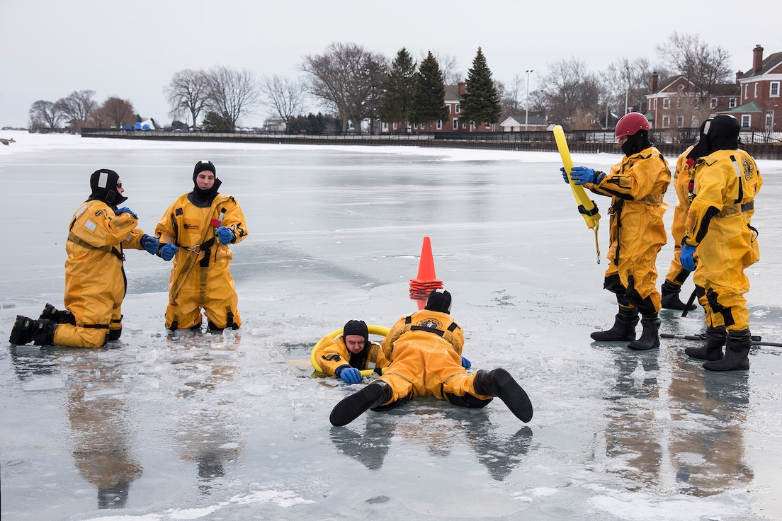 Firefighters of the 127th Civil Engineering Squadron, assigned to the Selfridge Air National Guard Base fire department, practice victim-extraction during an ice rescue training exercise on Lake St. Clair, Harrison Township, Mich. on Jan. 31, 2017.