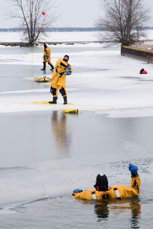 Firefighters with the Selfridge Air National Guard Base Fire Department practice using a throw rope from a long-distance during an ice rescue training exercise on Lake St. Clair, Harrison Township, Mich. on Jan. 31, 2017.