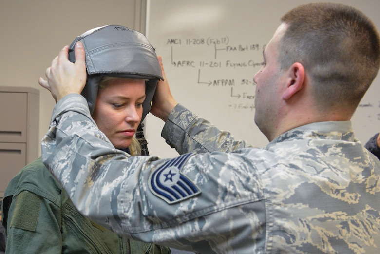 Tech Sgt. Brandon Blankensop, an Aircrew Flight Equipment Lead Trainer from the 20th Operations Support Squadron at Shaw Air Force Base, S.C., helps fit actress Elizabeth Banks with a helmet prior to her flight on an F-16 Fighting Falcon at the Minneapolis-St. Paul Air Reserve Station, Minn., Feb. 3, 2018. Banks' flight was one of many offered this week by the Viper Demo team prior to their fly-over for Super Bowl LII. (U.S. Air Force photo by Master Sgt. Eric Amidon)