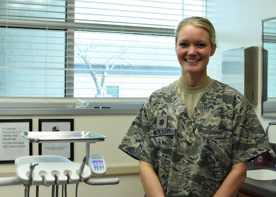 Maj. Lindsey Merchant, 301st Medical Squadron dentist, stands with her dental equipment at the squadron, Feb. 3, 2018, at Naval Air Station Fort Worth Joint Reserve Base, Texas. The dental clinic here provides Airmen with dental exams to assist in keeping them mission ready and deployable. (U.S. Air Force photo by Senior Airman Katherine Miller)