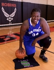 U.S. Air Force Staff Sgt. Charmaine Clark, a non-destructive inspections specialist assigned to the 116th Maintenance Squadron, 116th Air Control Wing, Georgia Air National Guard, poses for a photo in her Air Force basketball jersey.
