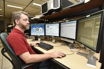 Joshua Diller, an AEDC system administrator at Arnold Air Force Base, works with an analysis software program for early engineering analyses related to pressure vessels. Diller, with the help of other AEDC team members, was able to install the software, which is more than 20 years old, and make it useable on the current system. (U.S. Air Force photo/Rick Goodfriend)