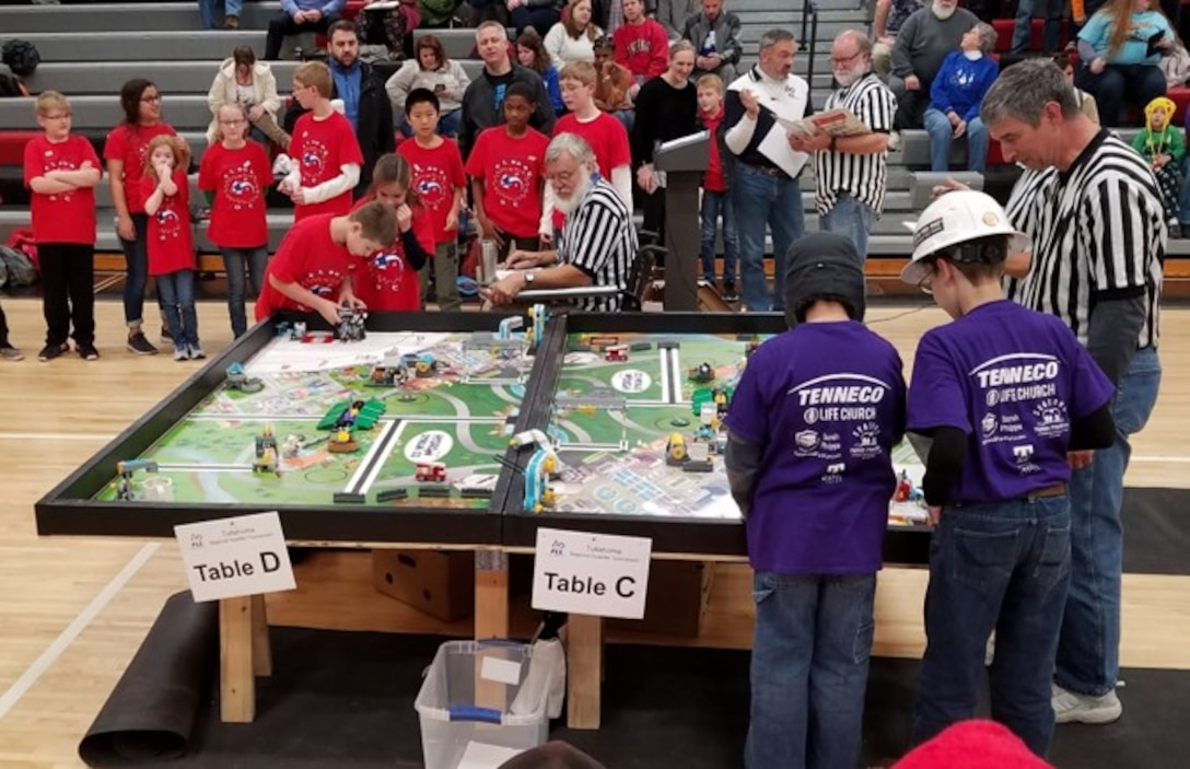 With their robot programmed using LEGO MINDSTORMS® technology, middle school-age FIRST® LEGO® League (FLL) teams compete on a table top playing field during the FLL Qualifying Tournament held Dec. 9 in Manchester. Of the 24 FLL teams sponsored by the Arnold Air Force Base Science, Technology, Engineering and Mathematics (STEM) Education Outreach Program, 10 did well enough to compete at the East Tennessee Championship competition in February. A total of 26 FLL teams participated in the qualifying tournament. (Courtesy photos)