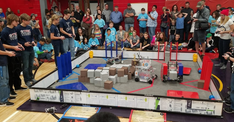 As the FIRST® LEGO® League (FLL) Qualifying Tournament judges deliberate over the final scores, four of six FIRST® Tech Challenge Teams sponsored by the Arnold STEM program put on a scrimmage with the robots they've programmed to compete at the high school level. (Courtesy photo)