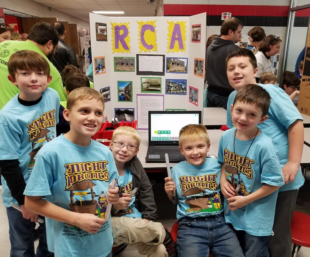 These elementary students participate as  FIRST® LEGO® League Junior Teams at the FIRST® LEGO® League (FLL) Qualifying Tournament held Dec. 9 in Manchester. To prepare for the competitions, students research a real-world problem, such as food safety, recycling or energy, and then develop a solution and present their results. (Courtesy photos)