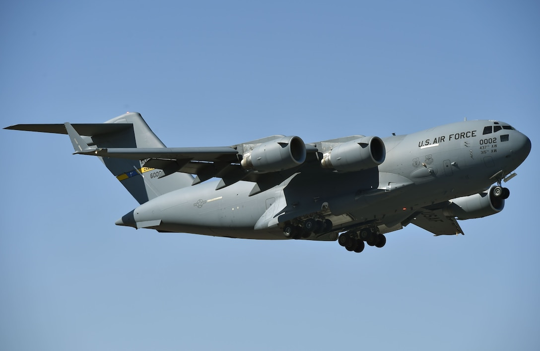 A C-17 Globemaster III assigned to the 437th Airlift Wing flies over Joint Base Charleston's North Auxiliary Airfield, near Orangeburg, South Carolina., providing airlift support to Airmen from the 321st Contingency Response Squadron, 621st Contingency Response Wing, during Exercise Crescent Moon Jan. 30.