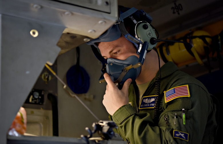 U.S. Air Force Senior Airman Chris Symes, 14th Airlift Squadron loadmaster, checks an oxygen mask before takeoff at Joint Base Charleston, S.C. Jan. 30, 2018.