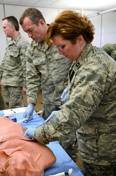 U.S. Air Force Capt. Frances Burress, with the 116th Medical Group (MDG), Georgia Air National Guard, places a chest tube during the thoracic trauma skills station of Advanced Trauma Life Support training at Nellis Air Force Base, Nev., Jan. 26, 2018.